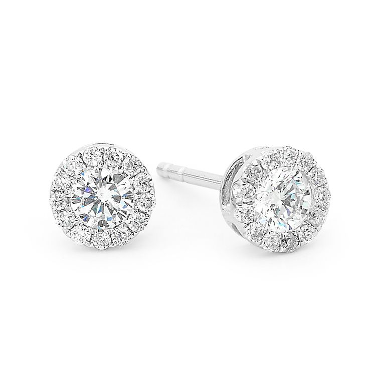 Diamond halo studs  #diamonds #diamondsinternational #diamondjewellery #halo #studs