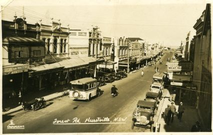This photo captures Forest Road looking south around 1930. Although the shopping strip has since undergone a lot of change, some of the architecture has survived and still stands today!
