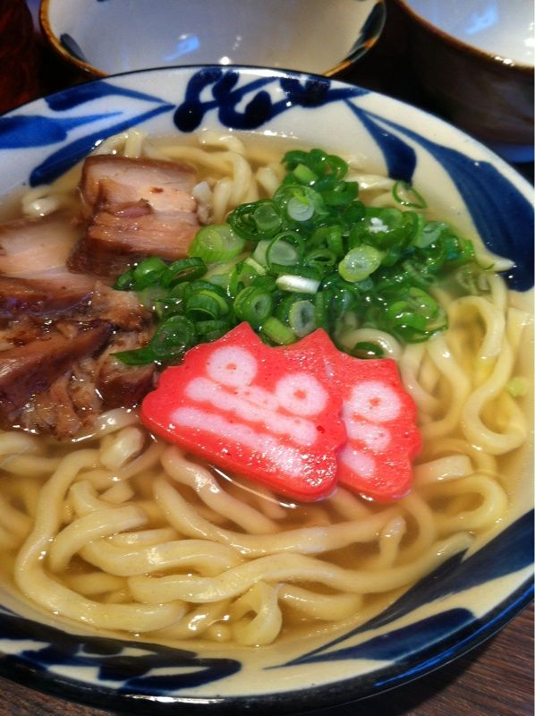Hot Soki Soba Noodles Soup with Pork Belly and Kamaboko Surimi Fish Cake (Local Cuisine of Okinawa Japan)   シーサーかまぼこがのった沖縄ソーキそば