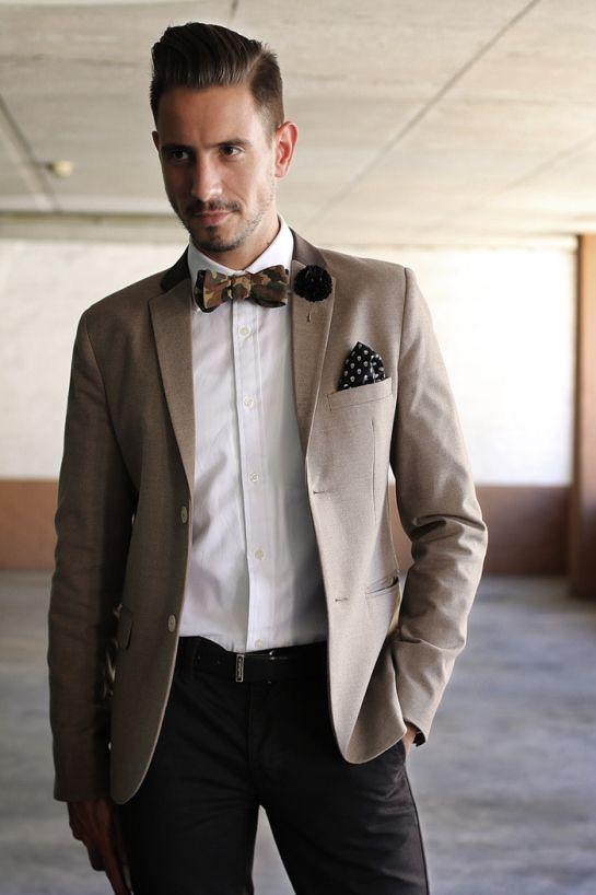 Brown contrast collar jacket, white shirt, camo bow tie, black lapel flower,
