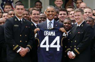 WASHINGTON, DC - APRIL 18: U.S. President Barack Obama (2nd L) holds a gift…