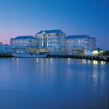 Kerzner's The Table Bay Hotel, located on Cape Town's Victoria & Alfred Waterfront at night from the port | Cape Town, South Africa
