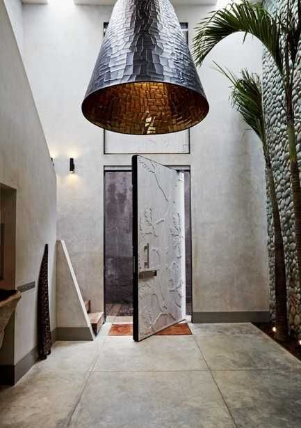 unique lighting and pebble wall design for foyer decorating