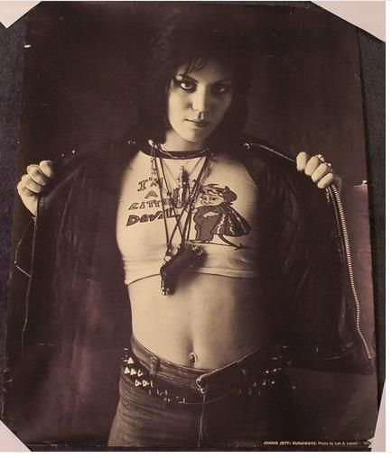 """The Godmother of Punk"" . Born Joan Marie Larkin in Pennsylvania in 1958,  Joan Jett is a feminist icon with three albums which are gold or platinum selling. She began her career as a founding member of The Runaways. In 1979 she came to England to start a solo career, performing with Paul Cook and Steve Jones. She began The Blackhearts in 1980. She is a massive animal rights activist with close links to PETA and an advocate for vegetarian/vegan living."