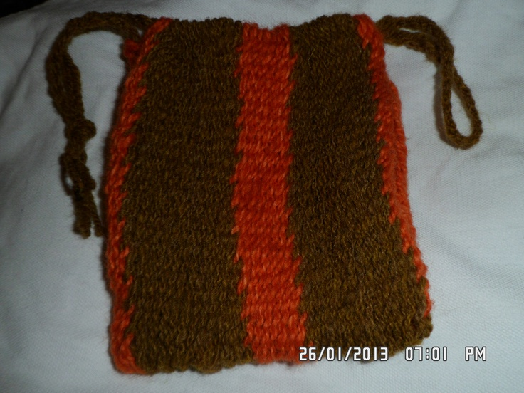 Natural brown Manx and madder dyed Norwegian wool's. First try at very fine sprang, a pouch for Viking living history.