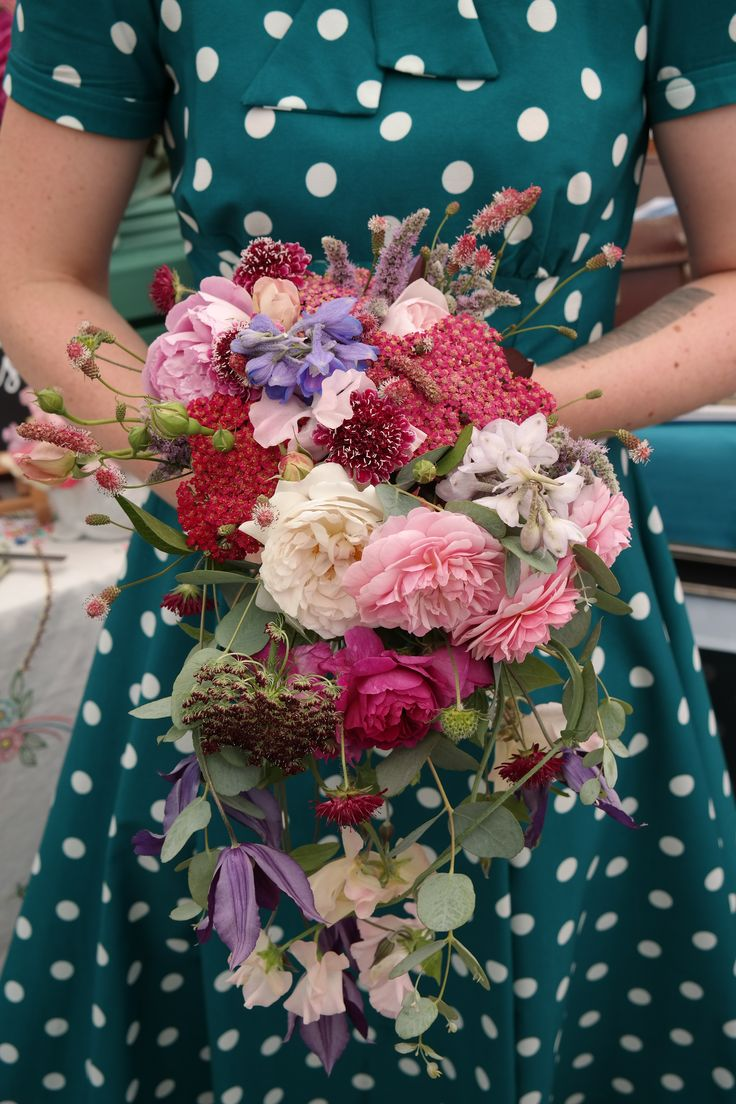 Hand-tied cascading bouquet of British flowers.
