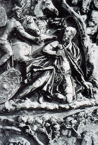 Decebalus scene on Column of Trajan. Depicts Dacian commander Decebalus committing suicide by a tree. The Romans admired his death, because he refused to die at the hands of the Romans.