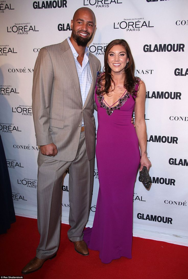 Pretty in pink: Hope Solo and Jerramy Stevens looked stylish as they arrived at the event...