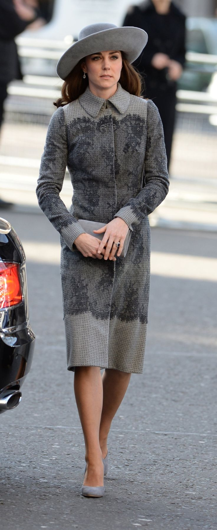 Kate Middleton's Latest Crown Coordinates With Her Coat- Middleton's Erdem coat has traces of Savile Row tailoring with lace being applied over a menswear-inspired fabric as a feminine counterpoint. It's this trompe l'oeil effect that gives the mother-of-two a fresh and streamlined spin on her classic prim-and-polished aesthetic
