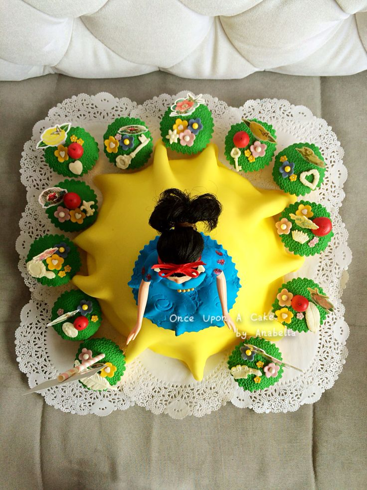 """My second Princess Cake with cupcakes ~ Princess Snow White (thanks to the help from a fashion designer who taught me how to cut """"fabric"""" in order for me to achieve the dress making process for Miss Princess Snow White)  #princesscakes #princesscupcakes #snowwhitecake #onceuponacakebyanabella #Anabellacakes #snowwhite #disneyprincess #disney #princess #topview"""