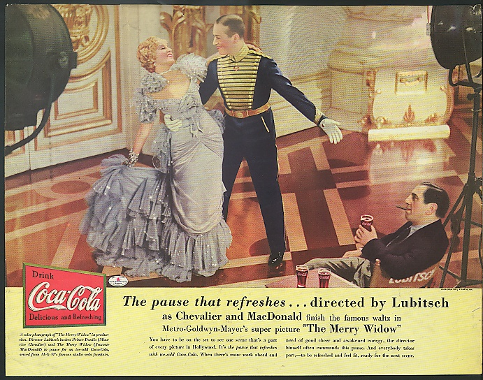 Coca-Cola color ad with Jeanette MacDonald, Maurice Chevalier and director Ernst Lubitsch on the set of The Merry Widow, 1934.