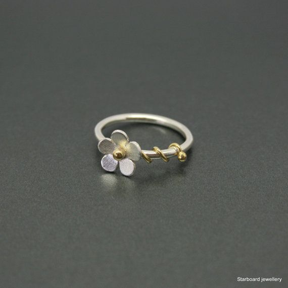 Silver daisy ring with brass tendrils  by starboardjewellery
