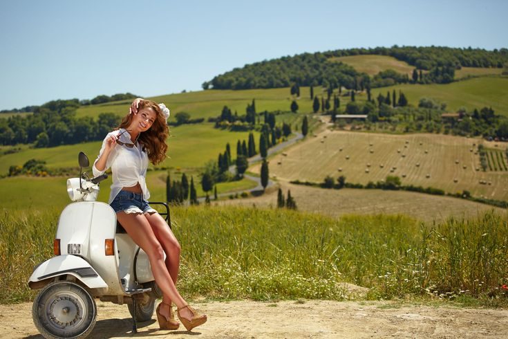 Young beautiful italian woman sitting on a italian scooter in tu by Tomasz Tulik on 500px