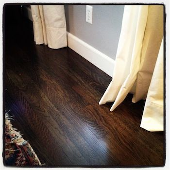 white oak floors and this was a 50/50 mix of Minwax Ebony and Jacobean. wall is San Antonio gray from B Moore
