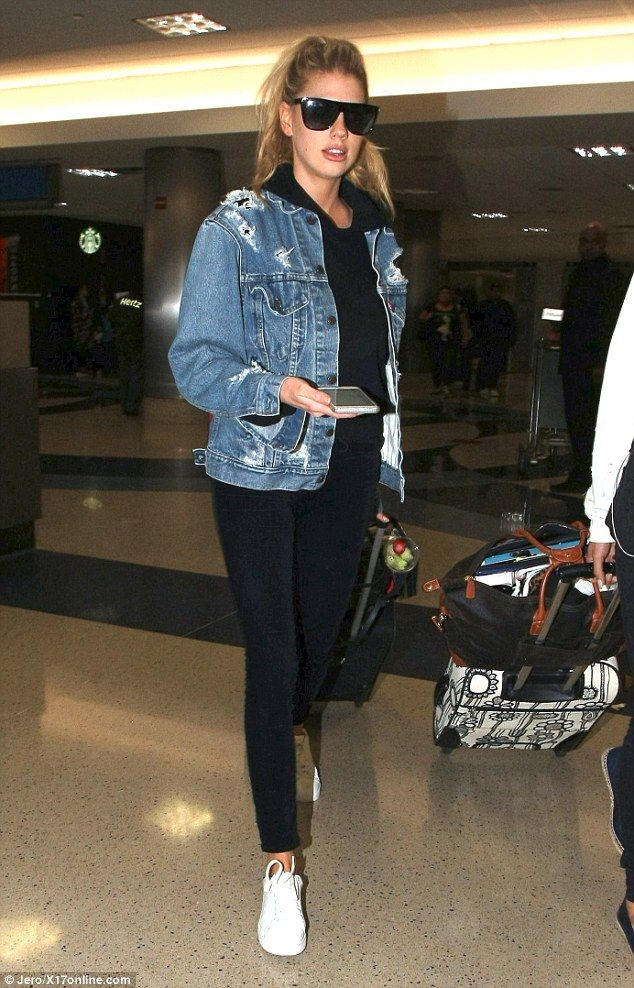 Modest traveler: Charlotte McKinney covered up her envy-inducing bikini body as she was spotted back in Los Angeles on Monday after heating up the beach in Miami over the weekend