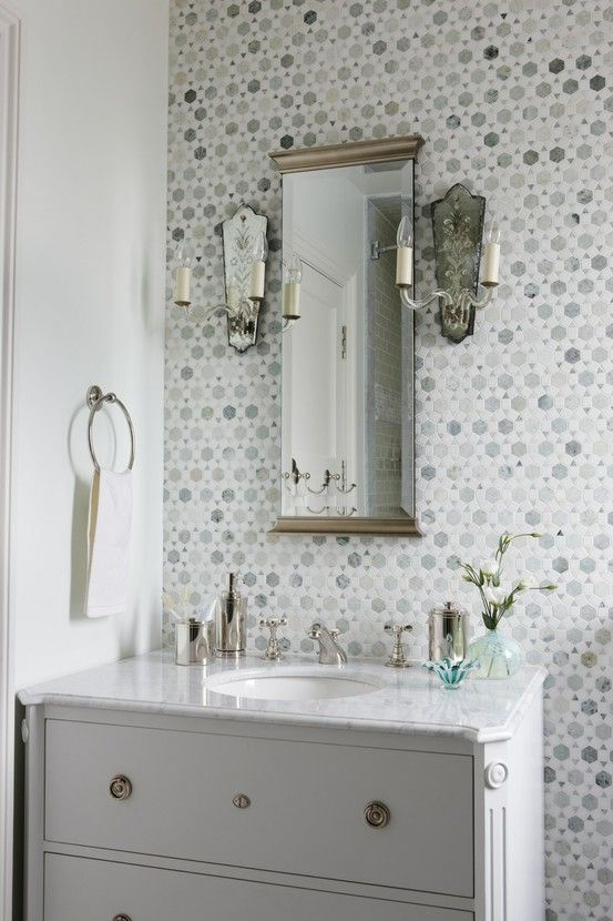 beautiful tile. love the lights and the mirror. and the sink/cabinet.