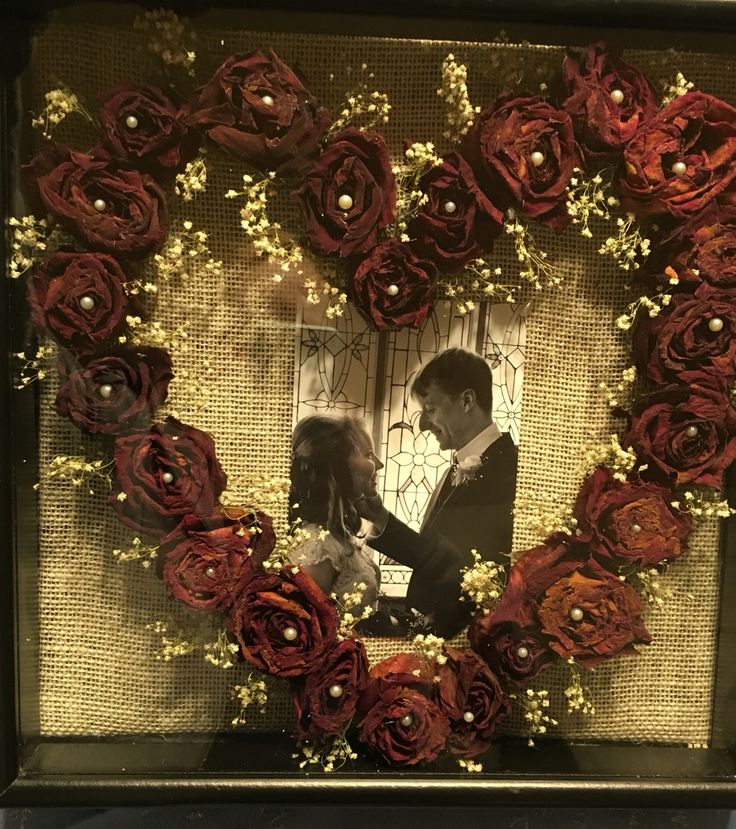 Shadow box with dried roses and baby's breath from wedding bouquet. #weddingcrafts