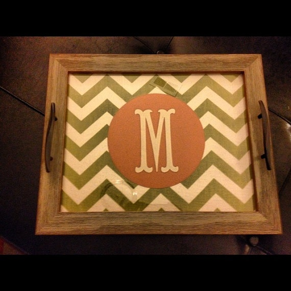 Old wood mixed with more modern patterns and colors. Could make this with an old picture frame and add handles.