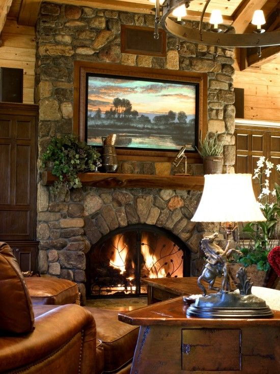 Great stone fireplace with built in large screen tv above for Decor over fireplace