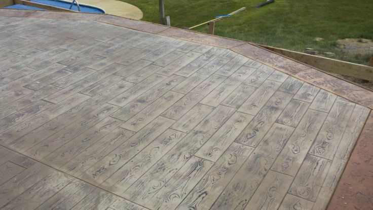 Wood Plank Stamped Concrete With Stone Texture Border Done