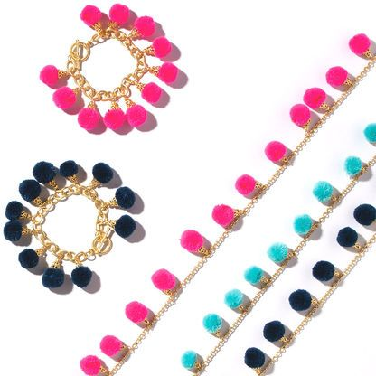 We are cheering for this pom pom  bracelet with gold finish.