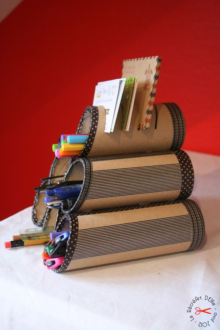 DIY pencil holder with toilet paper rolls and paper towel rolls.