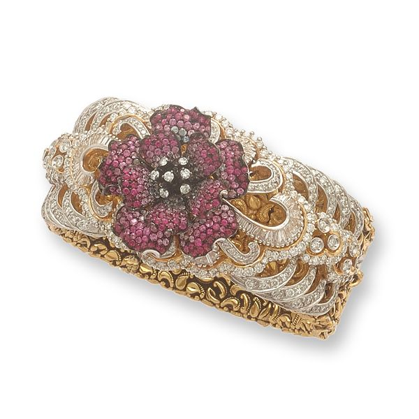 This beautiful cuff is crafted in 18k gold and set with baguettes and round brilliant diamonds. Rubies give a blooming look.