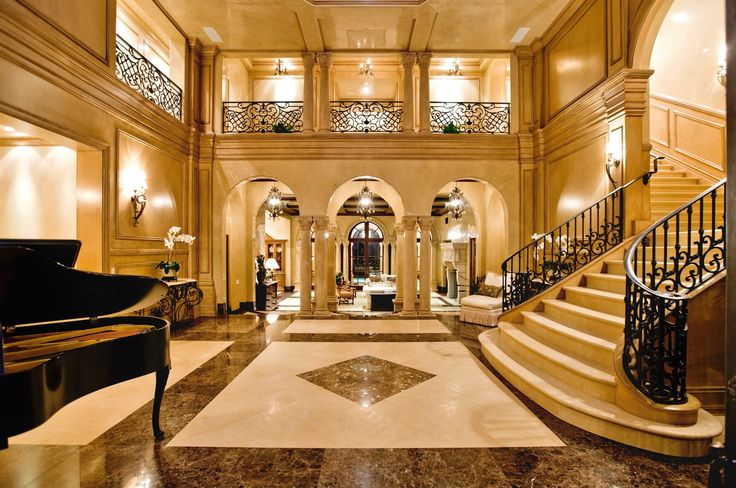 Luxury mansion home foyer staircase night view for Mansion foyer designs