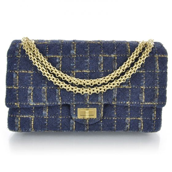 This is an authentic CHANEL Fantasy Tweed 2. 55 Reissue 226 Flap in Blue.