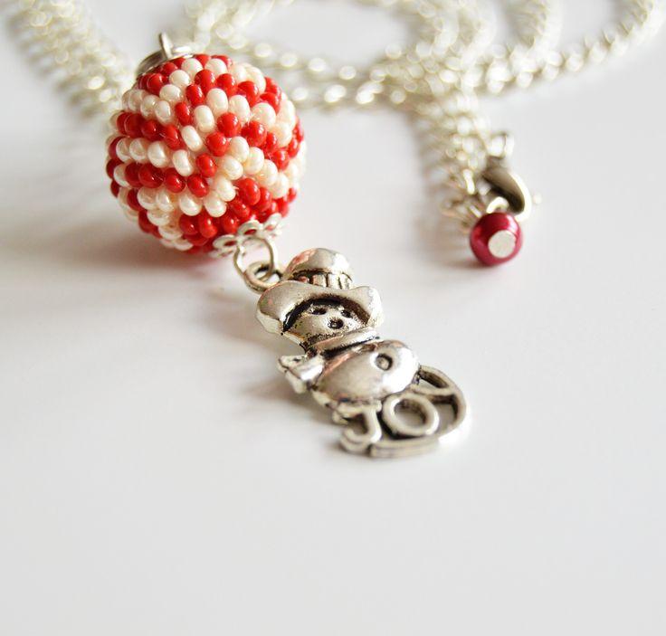 Joy+-+náhrdelník+Barva:+Červená,+béžová+Délka:+66cm+Řetízek+nemá+kroužek+ale+jen+karabinku+-+řetízek+má+velká+očka+takže+si+délku+nastavíte+jak+chcete.+Na+konci+řetízku+je+rudý+malý+korálek.