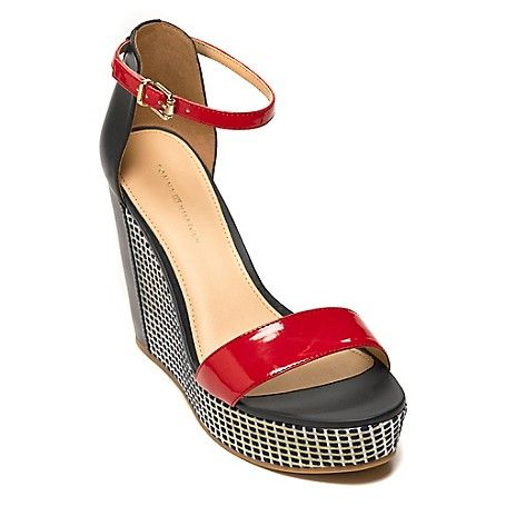 Tommy Hilfiger women's shoe. Beautifully crafted with from leather in an alluring silhouette, our standout sandal boasts a mod, wedge heel dressed in a woven stitch jacquard. The external platform not only gives you a boost in height, it keeps the walking easy. Prepare for compliments. <br>· Sandal silhouette in leather with fabric overlay. <br>· Adjustable ankle strap, padded footbed, gold buckle. <br>· 4.5 in heel, 1'' platform.<br>· Imported.<br>