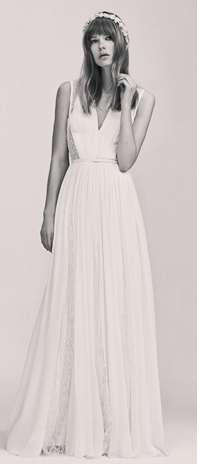 Elegant sleeveless belted wedding dress with lace underlay; Featured Dress: Elie Saab