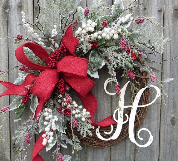 CHRISTMAS BURLAP WREATH In this beautiful Christmas wreath, realistic icy greenery, holly, and berries complement a beautiful bow. The bow is made