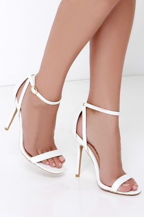 Keep the LuLu*s Remi White Snakeskin Ankle Strap Heels on hand for parties, weddings, dances, and nights at the club! White vegan leather has chic snakeskin embossing across a toe band, heel cup, and single sole, plus crisscrossing ankle straps that adjust with a gold buckle.
