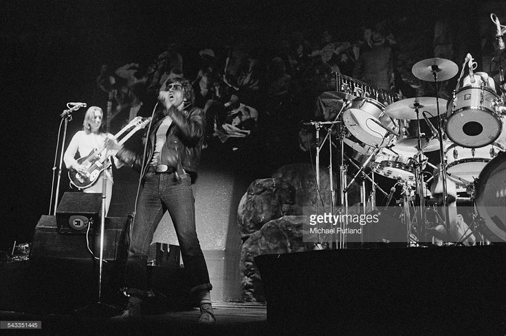 Mike Rutherford (left) and Peter Gabriel performing with English progressive rock group Genesis at the Empire Pool, London, 14th-15th April 1975.