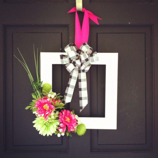 Repurposed Frame/door hanger - total cost $2 - $1for ribbon, flowers from craft room :) and white spray paint .97!!