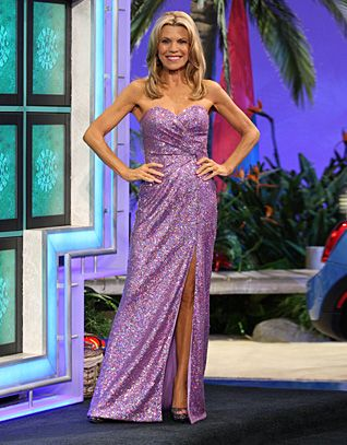 FAVIANA: Orchid sequined gown, strapless, diagonally pleated bodice, skirt w/slit front right, flared hemline w/train