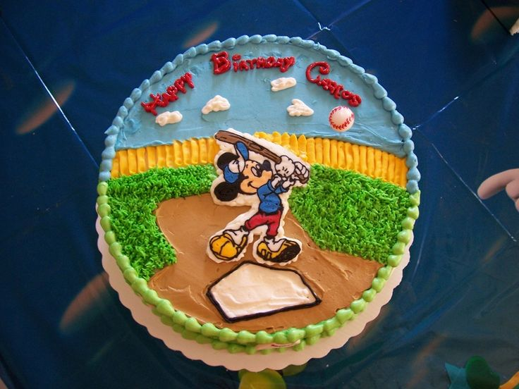 I made this cake for my 2 yr old son's birthday. It is a FBCT iced in buttercream with fondant baseballs on the sides.