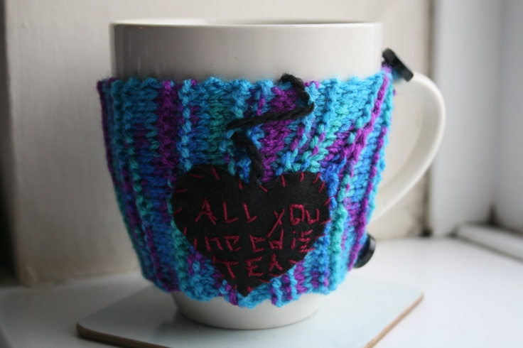 Hand knitted mug warmer - All you need is tea - multicoloured. £8.00, via Etsy.