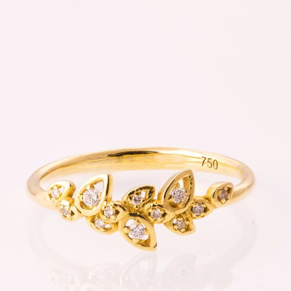 A handmade 14k gold leaves ring set with clear diamonds.  This ring is set with clear diamonds but can be set with any stone you choose,…