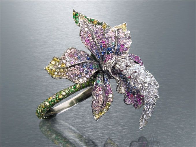 This ring is beyond incredible.  all this color makes me happy.  Can't you see this on the red carpet?  www.anna-hu.com