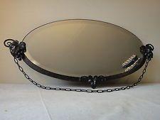 Ancien miroir ovale à suspendre art déco en fer forgé