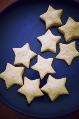 CHEESE STARS This is a new variant of an old and easy party favourite. The dough is mixed up in the processor and rolls out easily.  It may crack a bit for the first roll-out, but just resquidge together and roll out again like Play-Doh. Unlike other pastries, you don't have to be afraid of handling it. I keep rolling and re-rolling to the bitter end. You can use any cutter, but I'm a sucker for stars.
