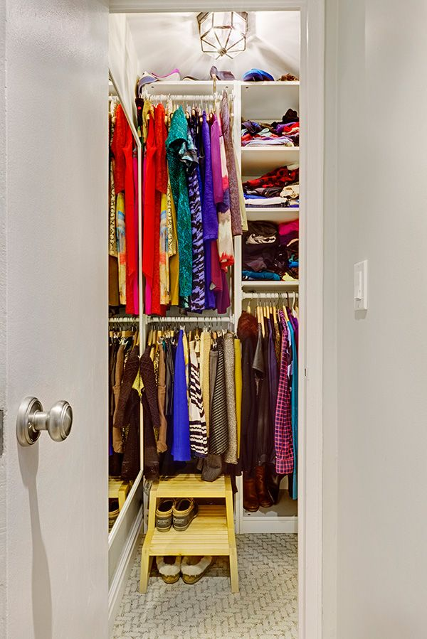 The last perk of this smart renovation came in the form of customizing the studio's remaining closet, including shelving, section dividers, and a full-length mirror.  Kelly's lovely, revamped studio is proof that no space is too small for showcasing personal taste and imagination.