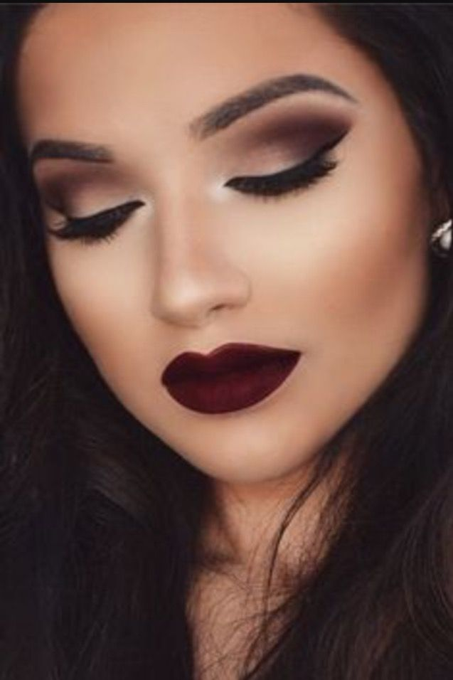 Fabulous deep lips with dark eye lids to top it off, perfect eyebrows and deep black mascara eyes.