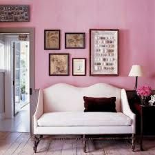 Neutral and vintage framed prints work well against chalky pink walls.