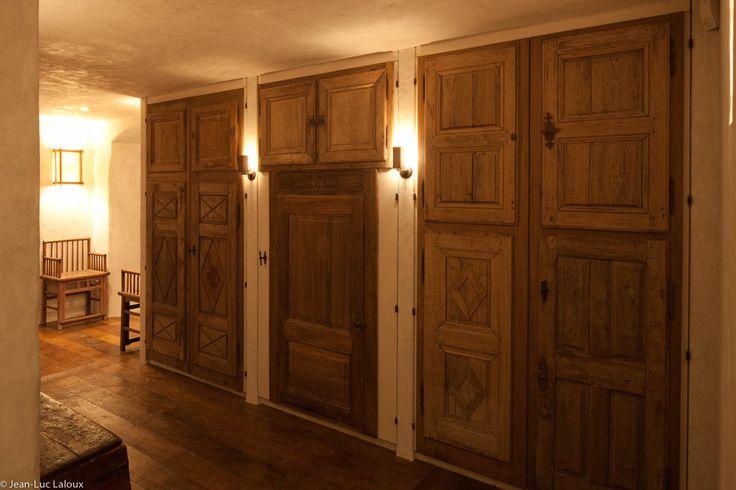 Vintage doors have been used to hide storage space #interiordesign #design #interiors #bespoke #homes #designer