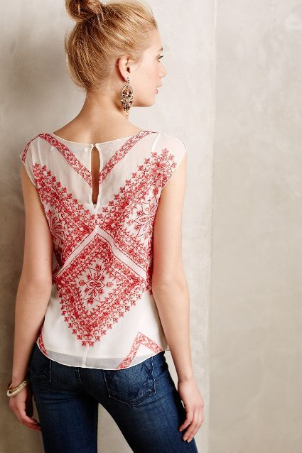 Holy gorgeous blouse with amazing embroidery detail.  And those earrings are awesome too.