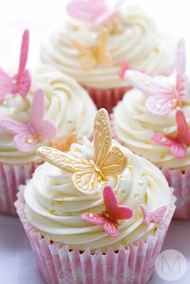 Pink and White cup Cakes for a candy bar or kitchen tea with yellow and pink butterflies.