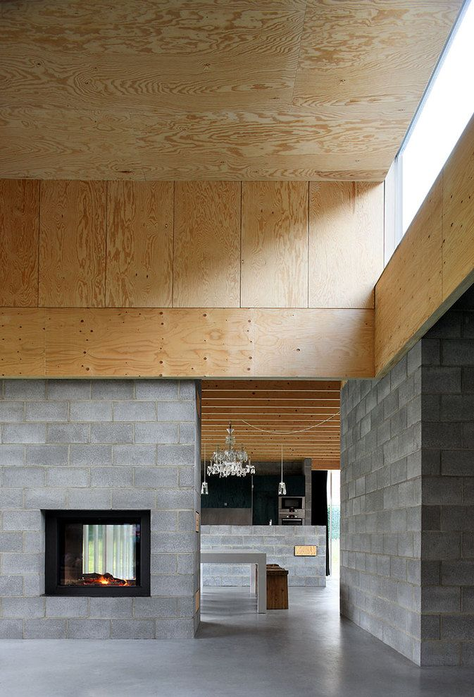 Waasmunster House by Ono Architectuur - I love how they have used raw construction materials as design elements; plywood, cinder block, and polished concrete.